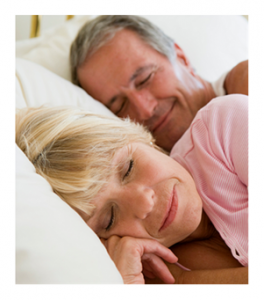 Mature couple sleeping