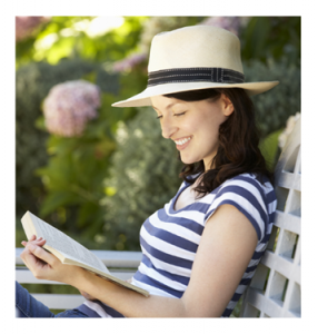 Woman Reading Book in Garden