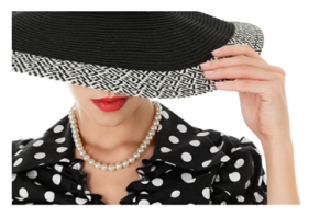 Woman in hat with pearl necklace