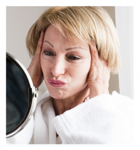 Mature Woman Making a Face in the Mirror