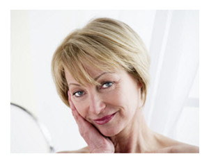 Mature Woman Looking at Herself in Mirror