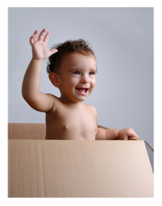 Smiling Baby in a Box