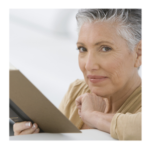 Mature Woman Reading a Book and Smiling
