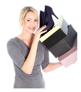 Smiling Woman Holding Shoe Boxes