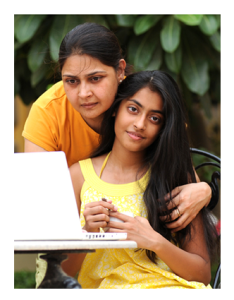 Indian Mother and Daughter Looking at Computer