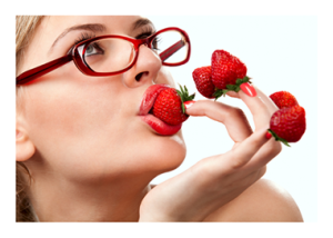 Woman Delighting in Strawberries