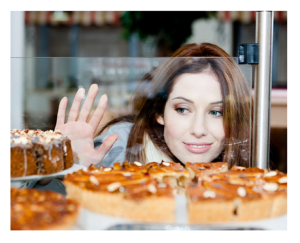 Woman Wanting Cake at Bakery