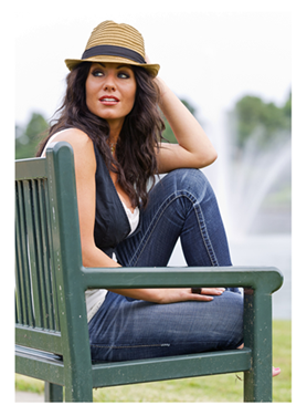Woman in Jeans Sitting on Bench