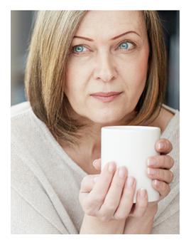 Thoughtful Woman Holding Coffee