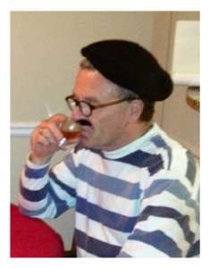 Frenchman sipping cognac