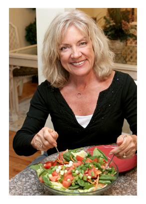 50 year old Woman Enjoying Healthy Salad