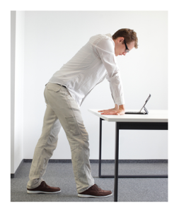 Man Flexing Wrists Standing at Desk
