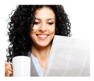 Woman Reading Newspaper with Coffee