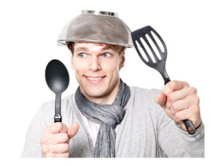 Crazy Kid With Cooking Utensils