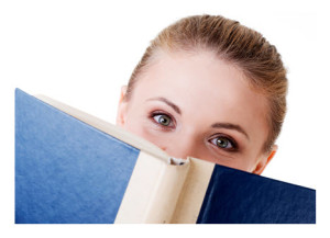 Woman Peering Over Open Book