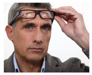 Man Thinking and Lifting Glasses