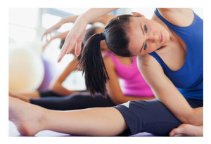 Women Stretching in Exercise Class