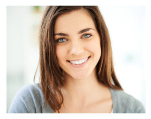 Happy Young Woman Smiling at Camera