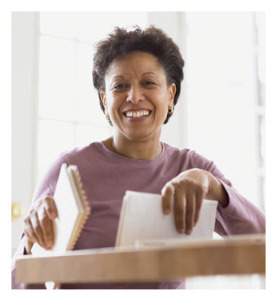 Smiling African American Woman Holding Bills