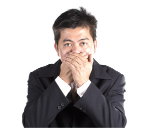 Businessman Covering His Mouth
