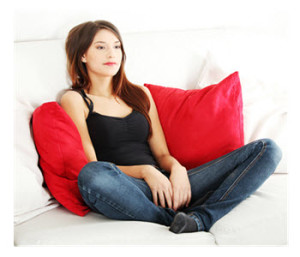 Sad Young Woman on Couch