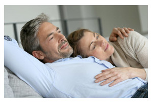 Mature Couple Relaxing on Sofa