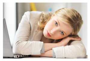 Bored Young Woman in Office