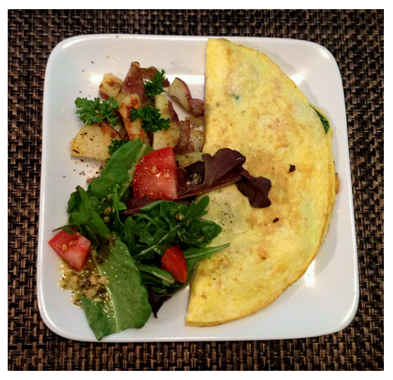 Omelet with salad and potatoes
