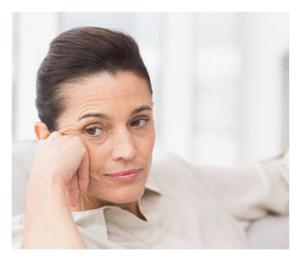 Thoughtful 50 year old woman