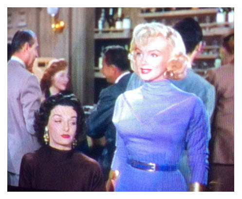 Marilyn in high neck three quarter length sleeves and subtle belt