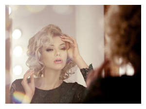Blonde Woman in Mirror