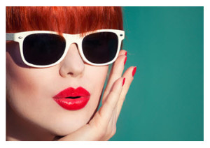 Woman with red hair red lips and sunglasses