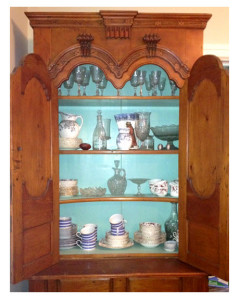 Grandmothers china in antique cupboard