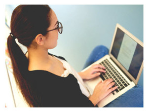 Young Woman Typing on a Laptop_Daily Plate of Crazy