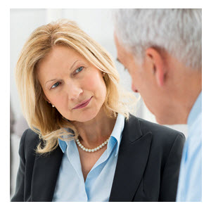 Female Business Executive Talking to Male CoWorker
