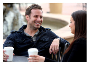 Couple Having Coffee Outside