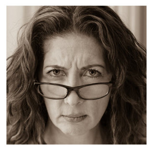 Middle Age Woman Stern Face With Glasses