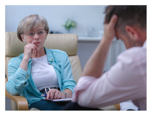 Therapist Listening to Male Patient
