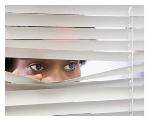 woman-looking-through-blinds